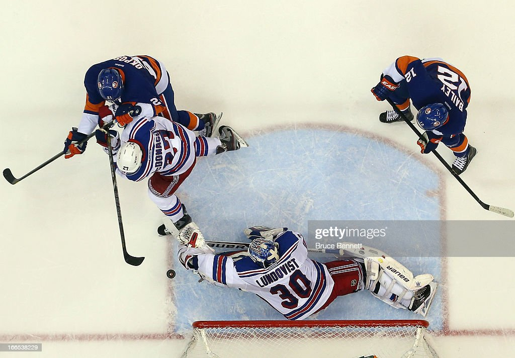 <a gi-track='captionPersonalityLinkClicked' href=/galleries/search?phrase=Henrik+Lundqvist&family=editorial&specificpeople=217958 ng-click='$event.stopPropagation()'>Henrik Lundqvist</a> #30 of the New York Rangers makes the save against the New York Islanders at the Nassau Veterans Memorial Coliseum on April 13, 2013 in Uniondale, New York. The Rangers defeated the Islanders inovertime 1-0.
