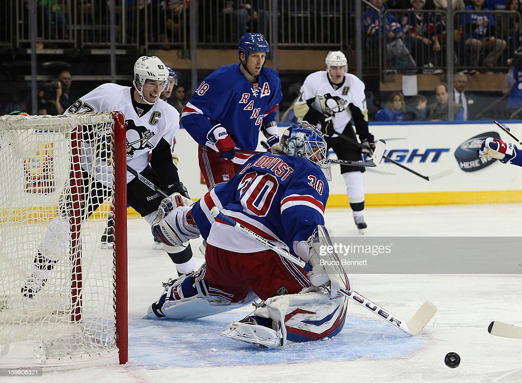 Henrik Lundqvist #30 of the New York Rangers makes the save as Sidney Crosby #87 of the Pittsburgh Penguins looks for the rebound at Madison Square Garden on January 20, 2013 in New York City. The Penguins defeated the Rangers 6-3.