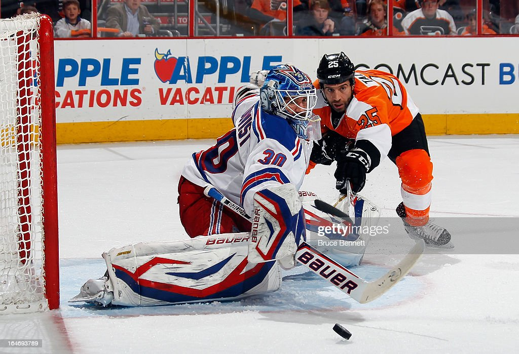 Henrik Lundqvist #30 of the New York Rangers makes the save in the second period as Maxime Talbot #25 of the Philadelphia Flyers looks for the rebound at the Wells Fargo Center on March 26, 2013 in Philadelphia, Pennsylvania.