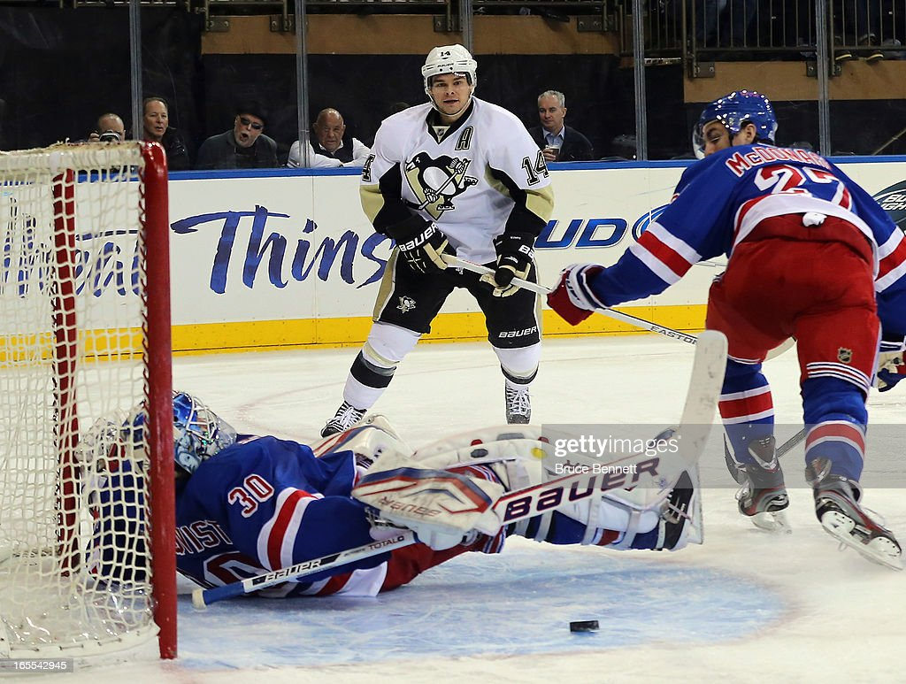 <a gi-track='captionPersonalityLinkClicked' href=/galleries/search?phrase=Henrik+Lundqvist&family=editorial&specificpeople=217958 ng-click='$event.stopPropagation()'>Henrik Lundqvist</a> #30 of the New York Rangers makes the save on <a gi-track='captionPersonalityLinkClicked' href=/galleries/search?phrase=Chris+Kunitz&family=editorial&specificpeople=604159 ng-click='$event.stopPropagation()'>Chris Kunitz</a> #14 of the Pittsburgh Penguins skates against the New York Rangers at Madison Square Garden on April 3, 2013 in New York City.