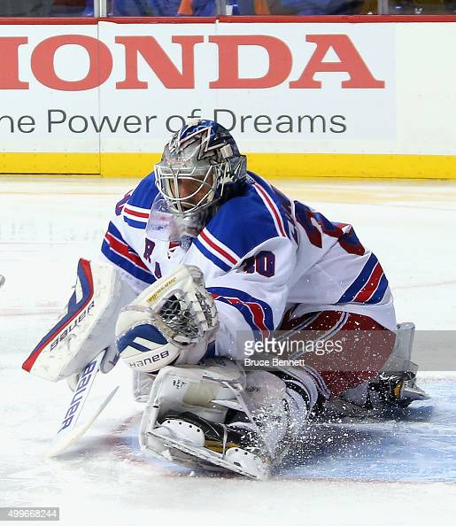 Henrik Lundqvist of the New York Rangers makes the second period save against the New York Islanders at the Barclays Center on December 2 2015 in the...