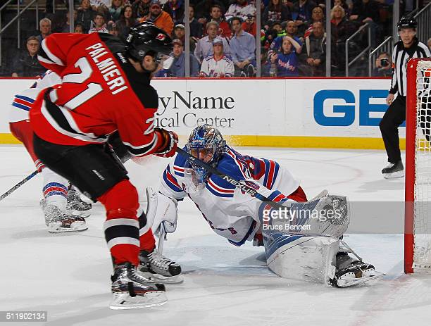Henrik Lundqvist of the New York Rangers makes the second period save on Kyle Palmieri of the New Jersey Devils at the Prudential Center on February...