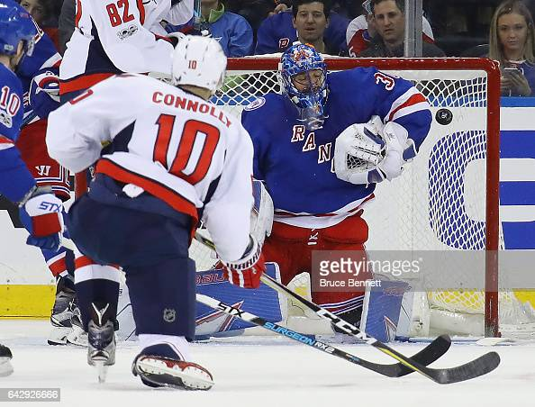 Henrik Lundqvist of the New York Rangers makes the second period save on Brett Connolly of the Washington Capitals at Madison Square Garden on...