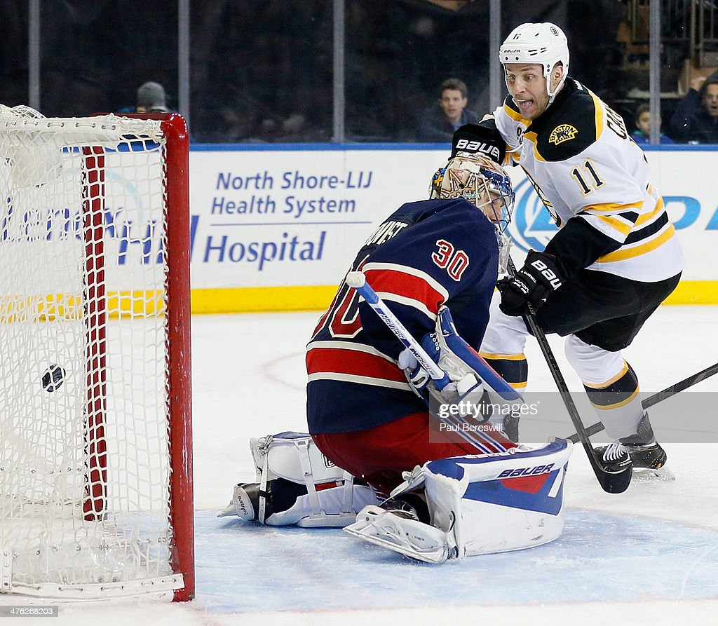 Henrik Lundqvist of the New York Rangers misses a shot for a goal by Gregory Campbell of the Boston Bruins during the third period of an NHL hockey...