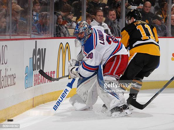 Henrik Lundqvist of the New York Rangers moves the puck in front of Kevin Porter of the Pittsburgh Penguins at Consol Energy Center on February 10...