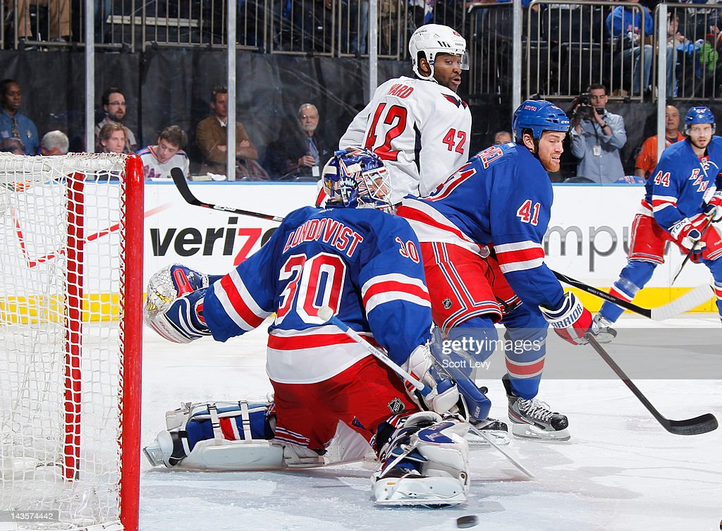 Henrik Lundqvist #30 of the New York Rangers protects the net against Joel Ward #42 of the Washington Capitals in Game One of the Eastern Conference Semifinals during the 2012 NHL Stanley Cup Playoffs at Madison Square Garden on April 28, 2012 in New York City.