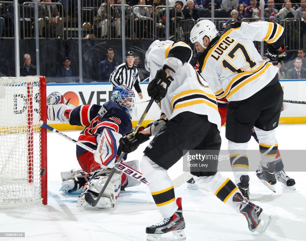 Henrik Lundqvist #30 of the New York Rangers protects the net against Milan Lucic #17 of the Boston Bruins at Madison Square Garden on January 23, 2013 in New York City.