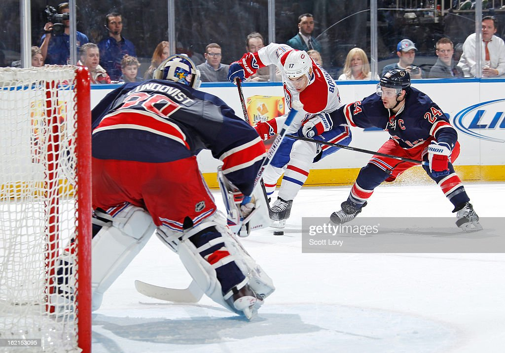 <a gi-track='captionPersonalityLinkClicked' href=/galleries/search?phrase=Henrik+Lundqvist&family=editorial&specificpeople=217958 ng-click='$event.stopPropagation()'>Henrik Lundqvist</a> #30 of the New York Rangers protects the net against <a gi-track='captionPersonalityLinkClicked' href=/galleries/search?phrase=Rene+Bourque&family=editorial&specificpeople=685715 ng-click='$event.stopPropagation()'>Rene Bourque</a> #17 of the Montreal Canadiens at Madison Square Garden on February 19, 2013 in New York City.