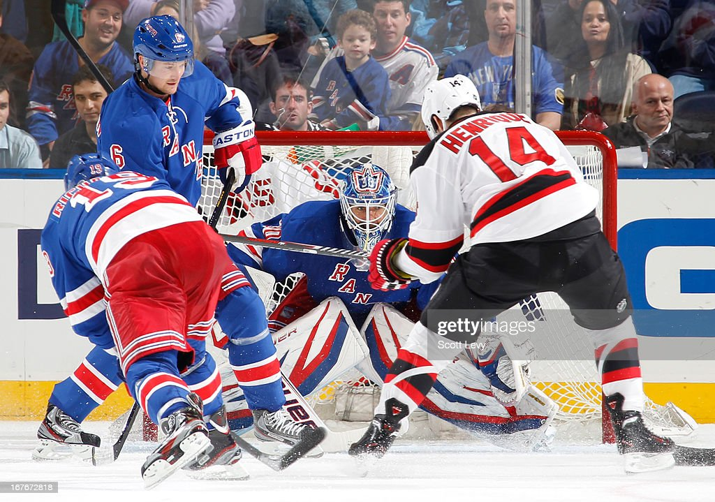 Henrik Lundqvist #30 of the New York Rangers protects the net against Adam Henrique #14 of the New Jersey Devils at Madison Square Garden on April 27, 2013 in New York City. The Rangers defeat the Devils 4-0.