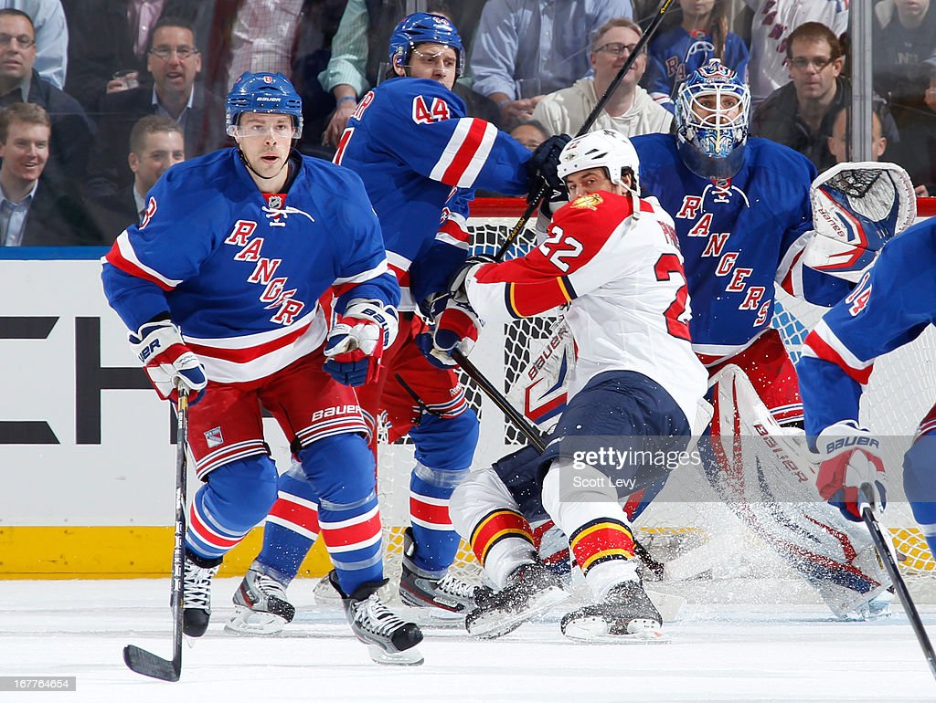 Henrik Lundqvist of the New York Rangers protects the net against George Parros of the Florida Panthers at Madison Square Garden on April 18 2013 in...