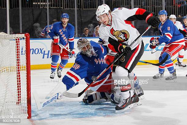 Henrik Lundqvist of the New York Rangers reaches back to make a save against Bobby Ryan of the Ottawa Senators at Madison Square Garden on December 6...
