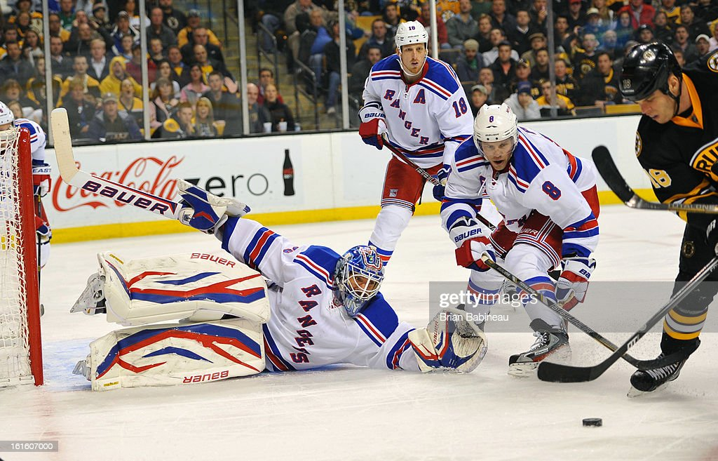 <a gi-track='captionPersonalityLinkClicked' href=/galleries/search?phrase=Henrik+Lundqvist&family=editorial&specificpeople=217958 ng-click='$event.stopPropagation()'>Henrik Lundqvist</a> #30 of the New York Rangers reaches out to make a save against the Boston Bruins at the TD Garden on February 12, 2013 in Boston, Massachusetts.