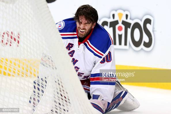 Henrik Lundqvist of the New York Rangers reacts after being hit by Cody Eakin of the Dallas Stars in the first period at American Airlines Center on...