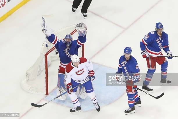 Henrik Lundqvist of the New York Rangers reacts after defeating the Montreal Canadiens 31 in Game Six of the Eastern Conference First Round during...