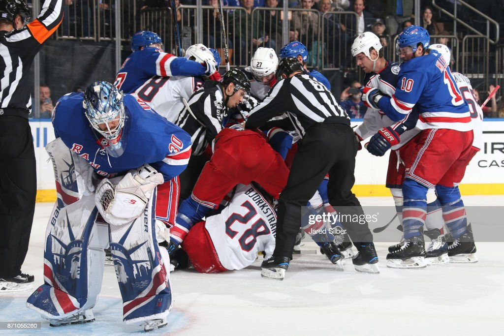 Henrik Lundqvist #30 of the New York Rangers reacts after getting hit by Oliver Bjorkstrand #28 of the Columbus Blue Jackets as the two teams tangle in the background at Madison Square Garden on November 6, 2017 in New York City.