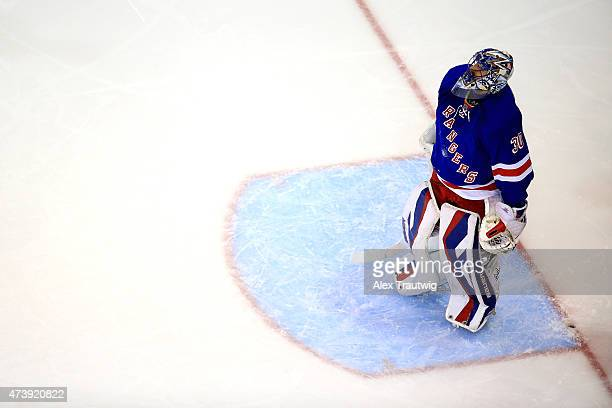 Henrik Lundqvist of the New York Rangers reacts after giving up a goal in the first period to Tyler Johnson of the Tampa Bay Lightning during Game...