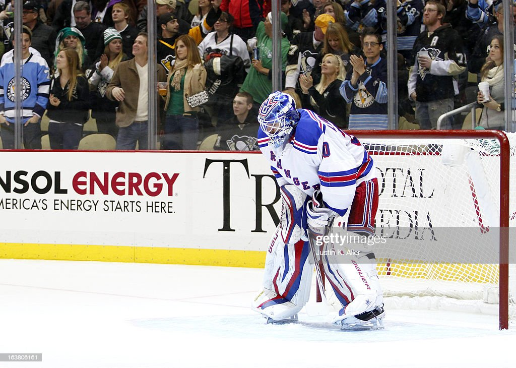 <a gi-track='captionPersonalityLinkClicked' href=/galleries/search?phrase=Henrik+Lundqvist&family=editorial&specificpeople=217958 ng-click='$event.stopPropagation()'>Henrik Lundqvist</a> #30 of the New York Rangers reacts after giving up two third period goals against the Pittsburgh Penguins during the game at Consol Energy Center on March 16, 2013 in Pittsburgh, Pennsylvania. The Penguins defeated the Rangers 3-0.