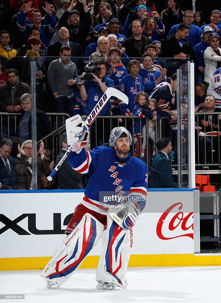 <a gi-track='captionPersonalityLinkClicked' href=/galleries/search?phrase=Henrik+Lundqvist&family=editorial&specificpeople=217958 ng-click='$event.stopPropagation()'>Henrik Lundqvist</a> #30 of the New York Rangers salutes fans as the number three star of the game against the Winnipeg Jets at Madison Square Garden on April 1, 2013 in New York City. The Rangers defeat the Jets 4-2.