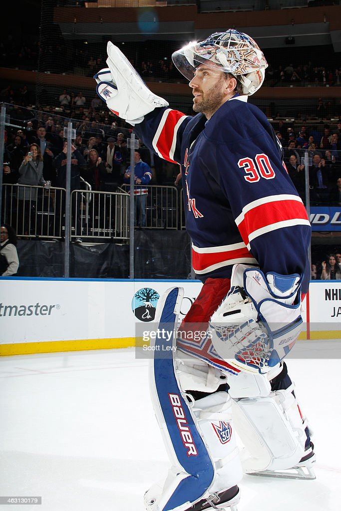 <a gi-track='captionPersonalityLinkClicked' href=/galleries/search?phrase=Henrik+Lundqvist&family=editorial&specificpeople=217958 ng-click='$event.stopPropagation()'>Henrik Lundqvist</a> #30 of the New York Rangers salutes the crowd after being named the first star of the game against the Detroit Red Wings at Madison Square Garden on January 16, 2014 in New York City.