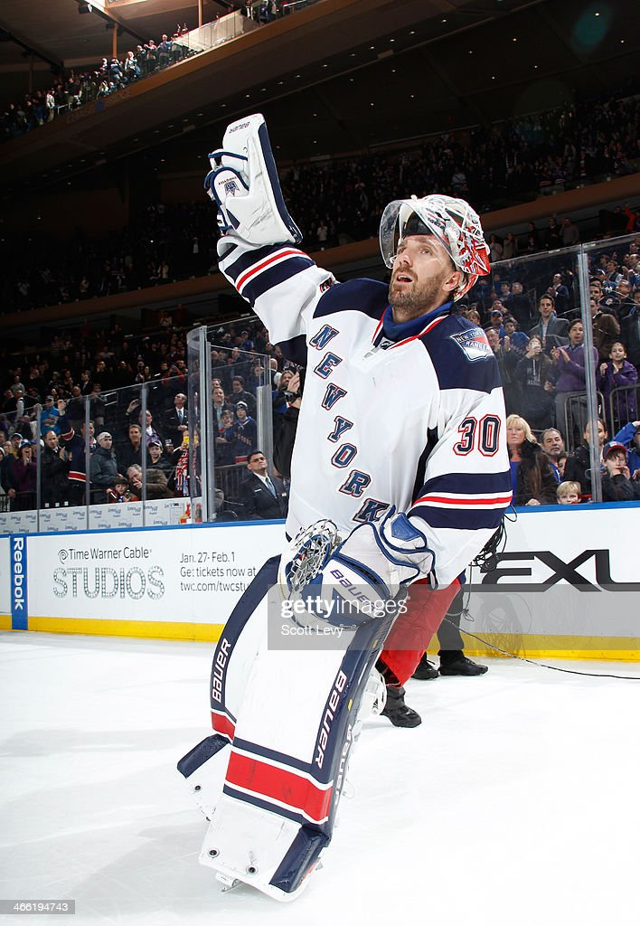 <a gi-track='captionPersonalityLinkClicked' href=/galleries/search?phrase=Henrik+Lundqvist&family=editorial&specificpeople=217958 ng-click='$event.stopPropagation()'>Henrik Lundqvist</a> #30 of the New York Rangers salutes the crowd after being named the first star of the game against the New York Islanders at Madison Square Garden on January 31, 2014 in New York City.