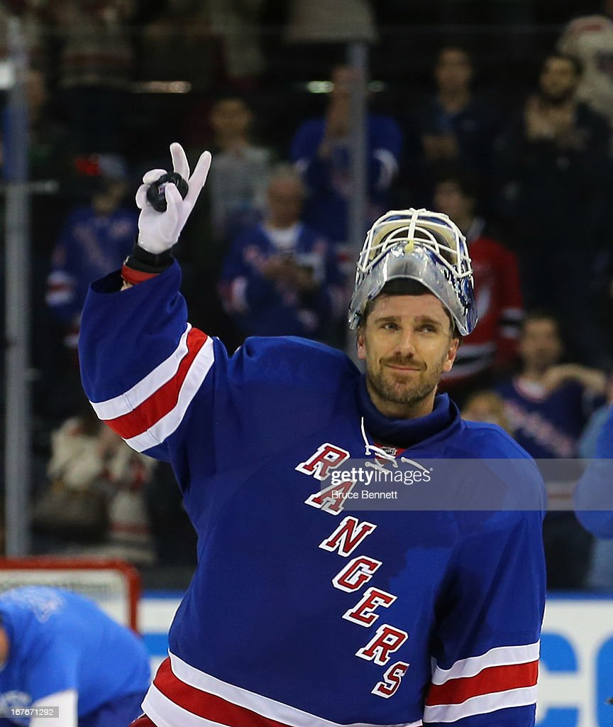 Henrik Lundqvist #30 of the New York Rangers salutes the crowd following his 4-0 shut out over the New Jersey Devils at Madison Square Garden on April 27, 2013 in New York City.