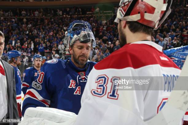 Henrik Lundqvist of the New York Rangers shakes hand with Carey Price of the Montreal Canadiens after the New York Rangers win 31 and advance out of...