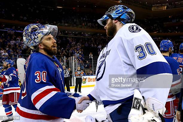 Henrik Lundqvist of the New York Rangers shakes hands with Ben Bishop of the Tampa Bay Lightning after the rangers lost by a score of 20 in Game...