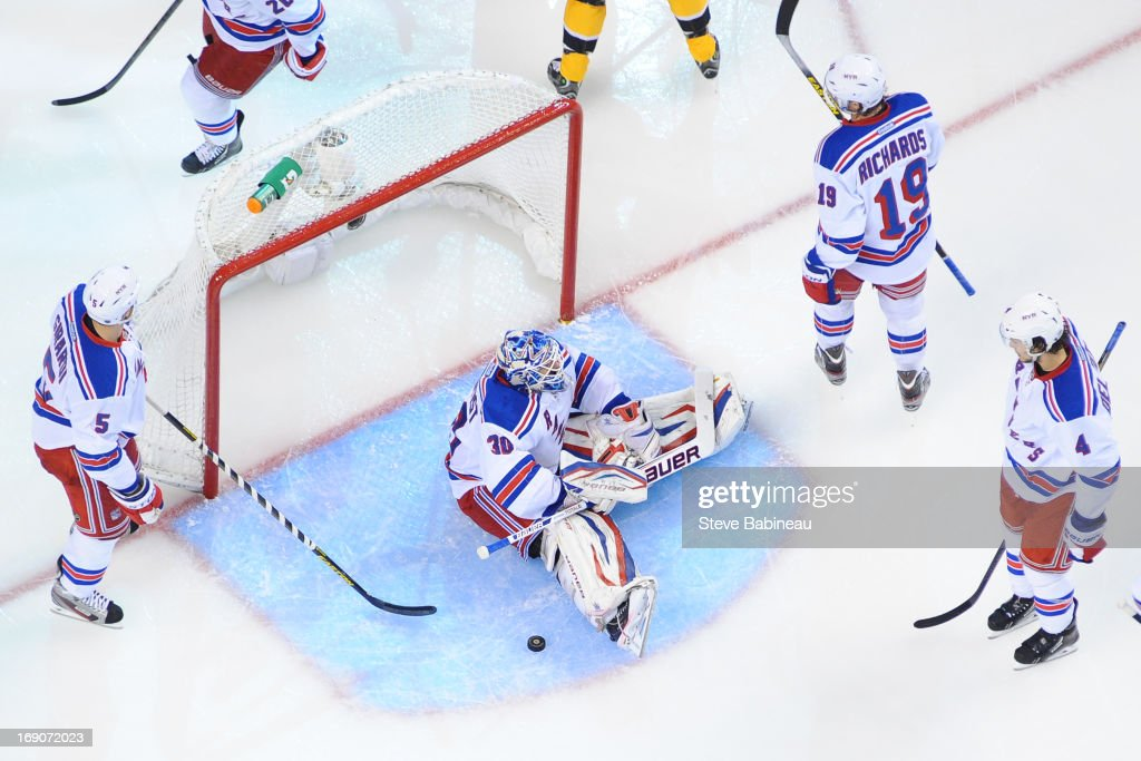 <a gi-track='captionPersonalityLinkClicked' href=/galleries/search?phrase=Henrik+Lundqvist&family=editorial&specificpeople=217958 ng-click='$event.stopPropagation()'>Henrik Lundqvist</a> #30 of the New York Rangers sits on the ice after a goal from the Boston Bruins in Game Two of the Eastern Conference Semifinals during the 2013 NHL Stanley Cup Playoffs at TD Garden on May 19, 2013 in Boston, Massachusetts.