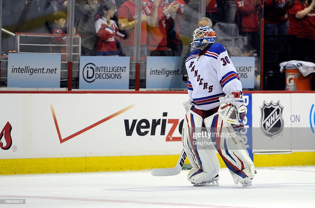 <a gi-track='captionPersonalityLinkClicked' href=/galleries/search?phrase=Henrik+Lundqvist&family=editorial&specificpeople=217958 ng-click='$event.stopPropagation()'>Henrik Lundqvist</a> #30 of the New York Rangers skates off the ice after giving up the game-winning goal in overtime against the Washington Capitals in Game Five of the Eastern Conference Quarterfinals during the 2013 NHL Stanley Cup Playoffs at the Verizon Center on May 10, 2013 in Washington, DC. Washington won the game 2-1.
