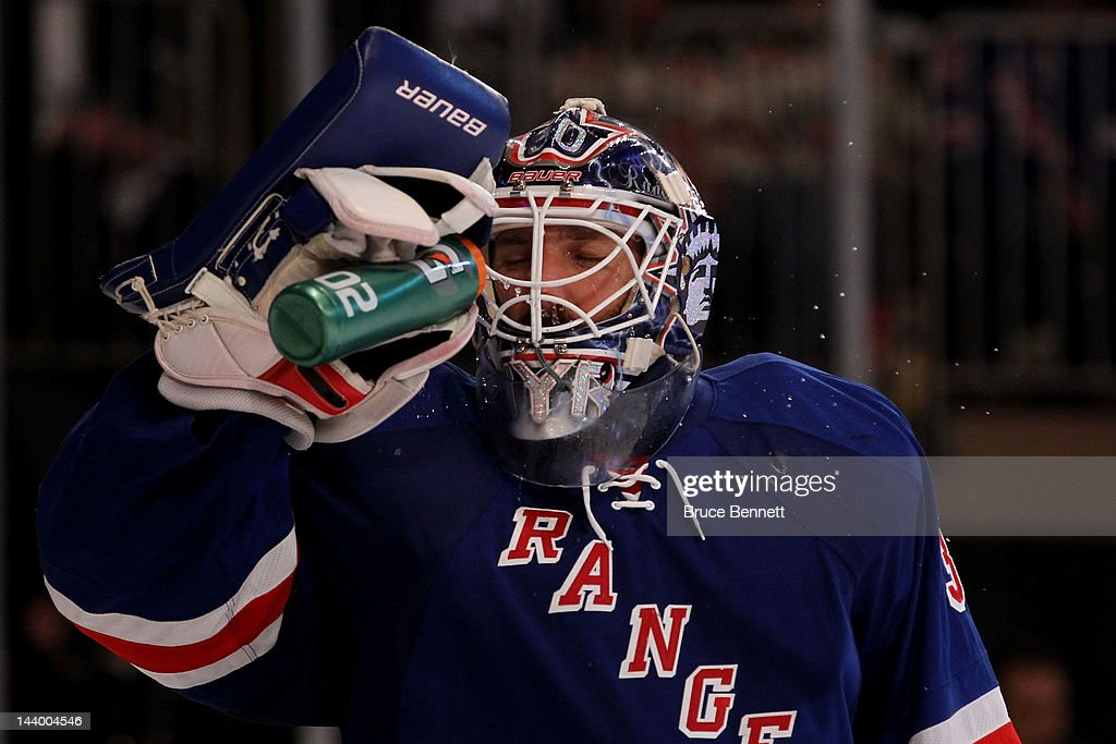 <a gi-track='captionPersonalityLinkClicked' href=/galleries/search?phrase=Henrik+Lundqvist&family=editorial&specificpeople=217958 ng-click='$event.stopPropagation()'>Henrik Lundqvist</a> #30 of the New York Rangers sprays his face with water against the Washington Capitals in Game Five of the Eastern Conference Semifinals during the 2012 NHL Stanley Cup Playoffs at Madison Square Garden on May 7, 2012 in New York City.