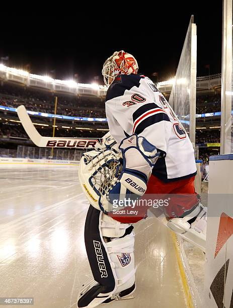 Henrik Lundqvist of the New York Rangers steps onto the ice before the game against the New York Islanders during the 2014 Coors Light NHL Stadium...