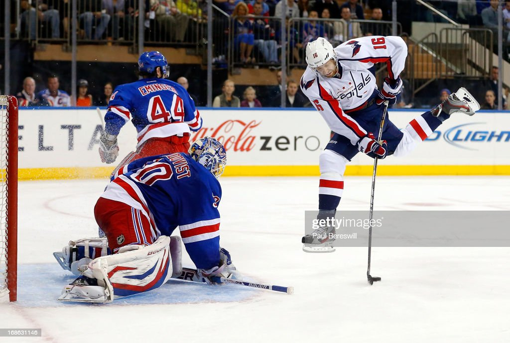 <a gi-track='captionPersonalityLinkClicked' href=/galleries/search?phrase=Henrik+Lundqvist&family=editorial&specificpeople=217958 ng-click='$event.stopPropagation()'>Henrik Lundqvist</a> #30 of the New York Rangers stops a breakaway by <a gi-track='captionPersonalityLinkClicked' href=/galleries/search?phrase=Eric+Fehr&family=editorial&specificpeople=566939 ng-click='$event.stopPropagation()'>Eric Fehr</a> #16 of the Washington Capitals in Game Six of the Eastern Conference Quarterfinals during the 2013 NHL Stanley Cup Playoffs at Madison Square Garden on May 12, 2013 in New York City. Rangers won 1-0.
