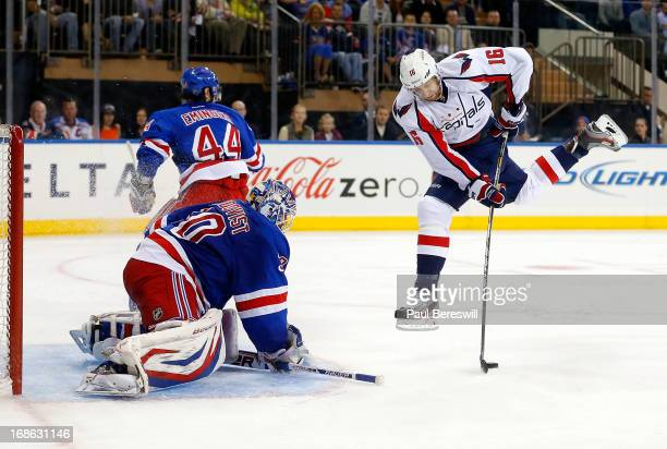 Henrik Lundqvist of the New York Rangers stops a breakaway by Eric Fehr of the Washington Capitals in Game Six of the Eastern Conference...