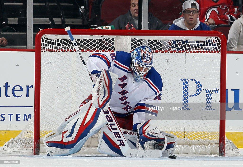 <a gi-track='captionPersonalityLinkClicked' href=/galleries/search?phrase=Henrik+Lundqvist&family=editorial&specificpeople=217958 ng-click='$event.stopPropagation()'>Henrik Lundqvist</a> #30 of the New York Rangers stops a shot against the New Jersey Devils at the Prudential Center on March 19, 2013 in Newark, New Jersey.