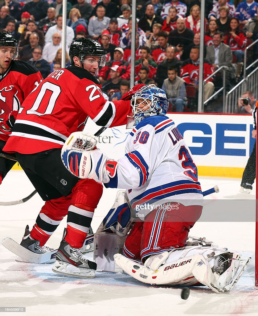<a gi-track='captionPersonalityLinkClicked' href=/galleries/search?phrase=Henrik+Lundqvist&family=editorial&specificpeople=217958 ng-click='$event.stopPropagation()'>Henrik Lundqvist</a> #30 of the New York Rangers stops a shot as <a gi-track='captionPersonalityLinkClicked' href=/galleries/search?phrase=Ryan+Carter+-+Ice+Hockey+Player&family=editorial&specificpeople=3144941 ng-click='$event.stopPropagation()'>Ryan Carter</a> #20 of the New Jersey Devils waits for the rebound at the Prudential Center on March 19, 2013 in Newark, New Jersey.