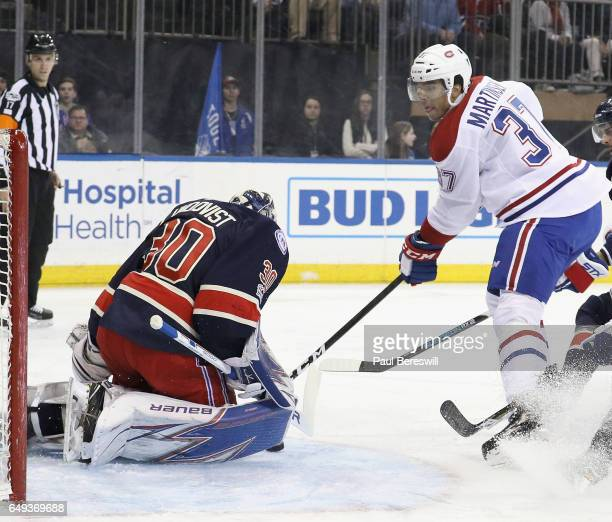 Henrik Lundqvist of the New York Rangers stops a shot by Andreas Martinsen of the Montreal Canadiens in an NHL hockey game at Madison Square Garden...