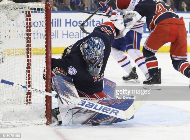 Henrik Lundqvist of the New York Rangers stops a shot by the Montreal Canadiens during the third period of an NHL hockey game at Madison Square...