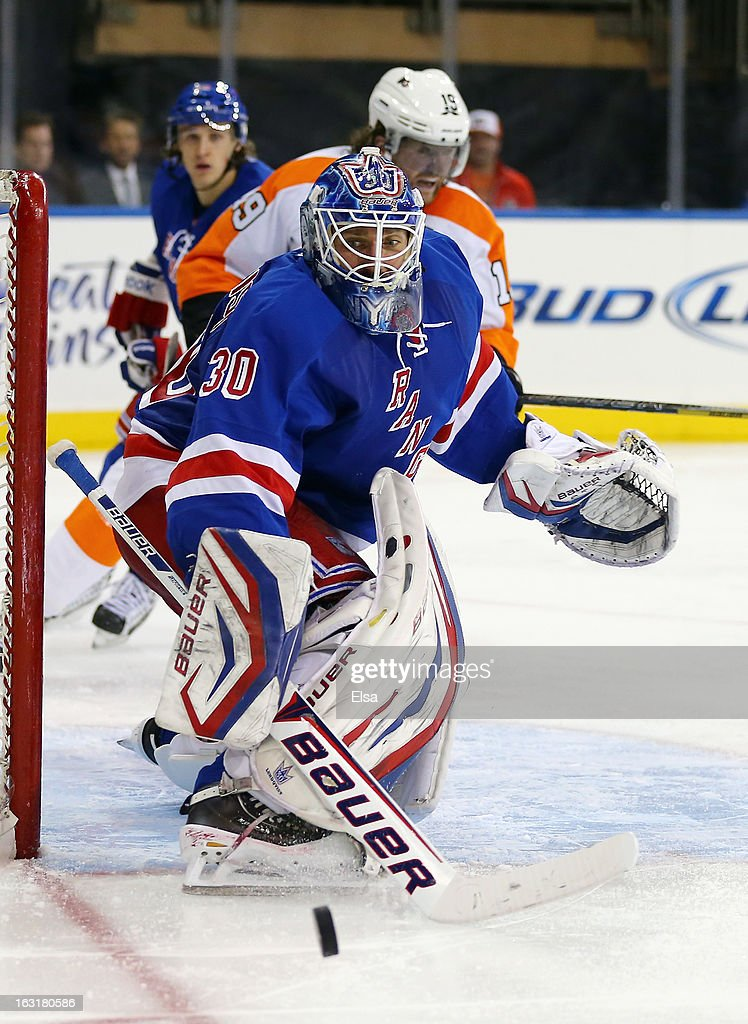 <a gi-track='captionPersonalityLinkClicked' href=/galleries/search?phrase=Henrik+Lundqvist&family=editorial&specificpeople=217958 ng-click='$event.stopPropagation()'>Henrik Lundqvist</a> #30 of the New York Rangers stops a shot in the third period against the Philadelphia Flyers on March 5, 2013 at Madison Square Garden in New York City.The New York Rangers defeated the Philadelphia Flyers 4-2.
