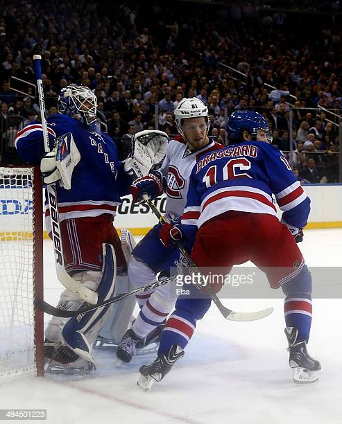 Henrik Lundqvist of the New York Rangers tends goal against Lars Eller of the Montreal Canadiens during Game Six of the Eastern Conference Final in...