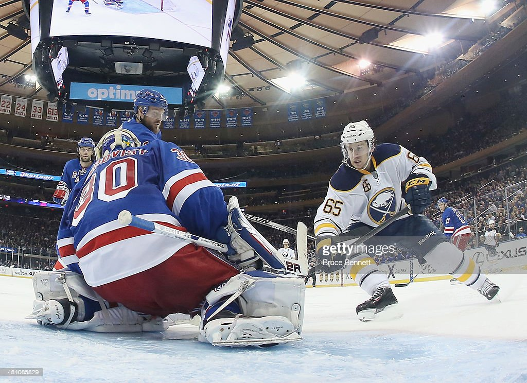 Henrik Lundqvist #30 of the New York Rangers tends net against Brian Flynn #65 of the Buffalo Sabres at Madison Square Garden on April 10, 2014 in New York City. The Rangers defeated the Sabres 2-1.