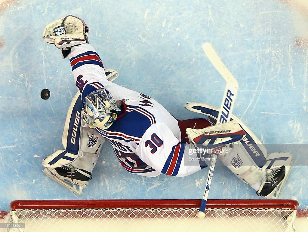 Henrik Lundqvist of the New York Rangers tends net against the New York Islanders at the Nassau Veterans Memorial Coliseum on January 27 2015 in...