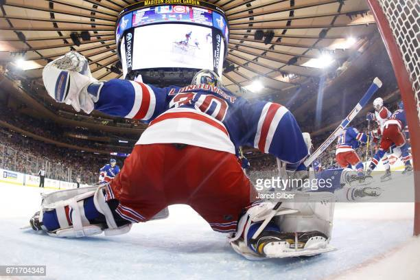 Henrik Lundqvist of the New York Rangers tends the net against the Montreal Canadiens in Game Six of the Eastern Conference First Round during the...