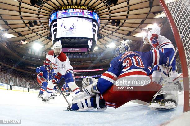 Henrik Lundqvist of the New York Rangers tends the net against Tomas Plekanec of the Montreal Canadiens in Game Six of the Eastern Conference First...