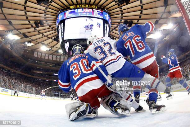 Henrik Lundqvist of the New York Rangers tends the net as Brian Flynn of the Montreal Canadiens crashes the net in Game Six of the Eastern Conference...