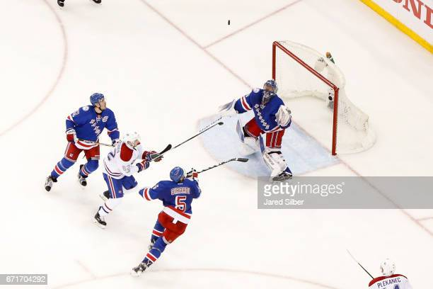 Henrik Lundqvist of the New York Rangers tends the net as Dan Girardi and Ryan McDonagh defend against Artturi Lehkonen of the Montreal Canadiens in...