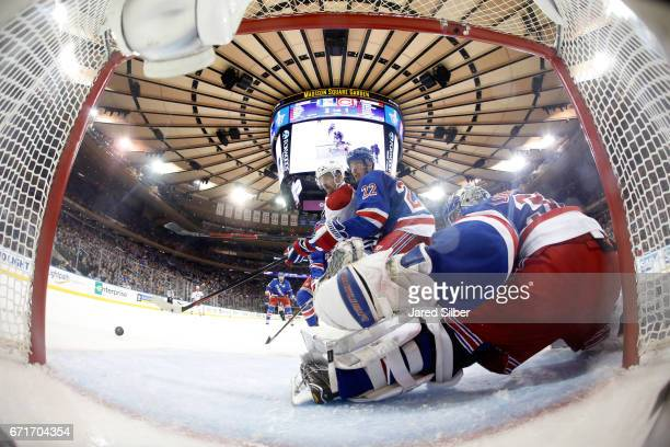 Henrik Lundqvist of the New York Rangers tends the net as Nick Holden defends against Tomas Plekanec of the Montreal Canadiens in Game Six of the...