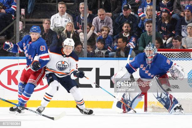 Henrik Lundqvist of the New York Rangers tends the net as Steven Kampfer defends against Jesse Puljujarvi of the Edmonton Oilers at Madison Square...