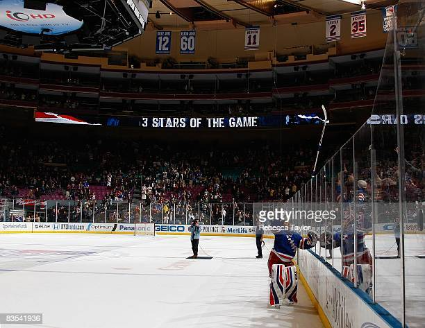 Henrik Lundqvist of the New York Rangers throws his stick to fans after a game won against the Pittsburgh Penguins on October 25 2008 at Madison...