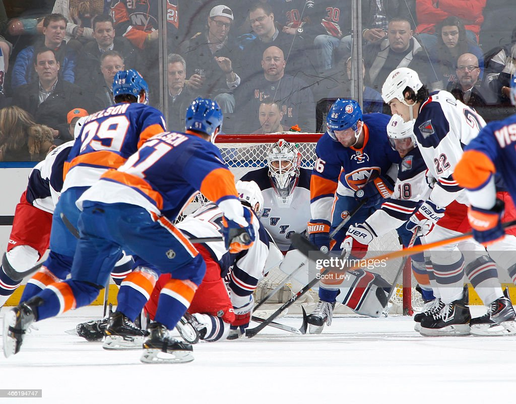 <a gi-track='captionPersonalityLinkClicked' href=/galleries/search?phrase=Henrik+Lundqvist&family=editorial&specificpeople=217958 ng-click='$event.stopPropagation()'>Henrik Lundqvist</a> #30 of the New York Rangers tracks the puck through bodies in front of the net against the New York Islanders at Madison Square Garden on January 31, 2014 in New York City.