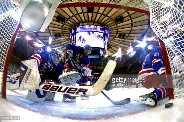 Henrik Lundqvist of the New York Rangers watches Daniel Briere of the Montreal Canadiens goal into the back of the net in Game Three of the Eastern...
